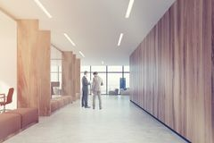 Wooden office corridor, brown sofas toned Stock Images