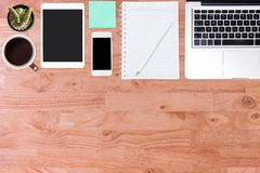 Top view of  wooden office desk table. Royalty Free Stock Images