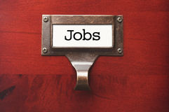 Wooden Office File Cabinet with Jobs Label Stock Images
