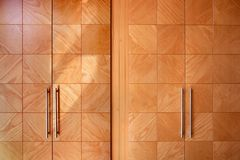 Wooden office modern closet orange doors. Interior design Royalty Free Stock Photography