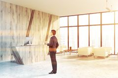 Wooden office reception area corner, man royalty free stock photography
