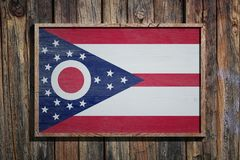 Wooden Ohio flag. 3d rendering of an Ohio State USA flag on a wooden frame and a wood wall Royalty Free Stock Image