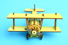 Wooden old airplane. A wooden model of an old airplane on a blue background Royalty Free Stock Photography