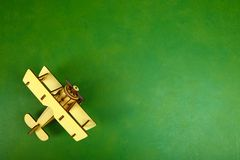 Wooden old airplane. A wooden model of an old airplane on a green background. op view Stock Photography