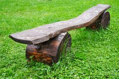 Wooden old bench on a background of green grass stock photos