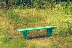 Wooden bench of resting place. Wooden old bench of resting place. retro toned royalty free stock photos