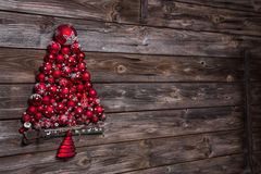 Wooden old christmas background with a red tree of balls. Stock Image
