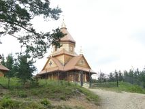 Wooden Old Church with the Golden Domes. Place of the religion Cult. Historical Heritage stock image