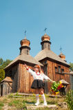 Wooden old church. Little Ukrainian girl. National Museum of Folk Architecture and Life Pirogovo Royalty Free Stock Image