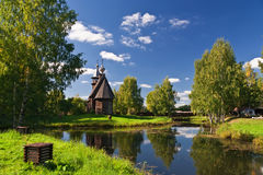 Wooden old church in park Stock Photo