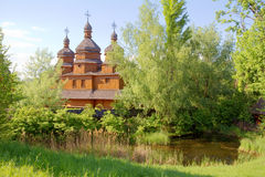 Wooden old church in park. Spring landscape Stock Photography