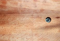 Wooden old cutting board background with knife marks and a round hole royalty free stock photos