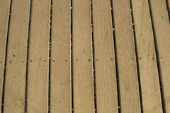 Wooden old deck pattern background. Wooden old brown deck pattern background royalty free stock image