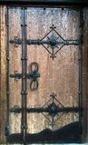 Wooden old door with forging elements Stock Images