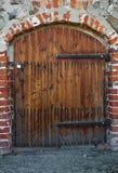 Wooden old door. Wooden door of brick cellar Royalty Free Stock Image