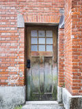 Wooden old door on Brick wall Architecture details. Wooden old door on Brick wall Architecture textured details Royalty Free Stock Photos