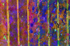 Mixed media artwork, abstract colorful artistic painted layer in dark brown, blue, pink, yellow color palette on grunge texture. Planks photography background stock photography