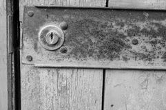 Wooden old door with a lock. Background stock photo