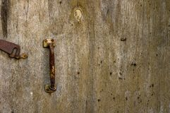 Wooden old door with a lock. Background royalty free stock photos