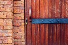Wooden Old Door Lock Bricks Wall Corner Background. Locked Entrance Handle Architecture Design Style royalty free stock images