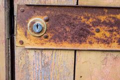 Wooden old door with a lock. Background stock photography