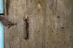 Wooden old door with a lock. Background royalty free stock images