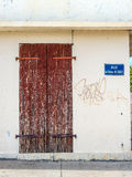 A wooden old door and plate and plate with name of the street, A Royalty Free Stock Image