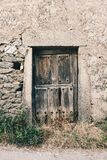 Old wooden door on a stone wall stock photos