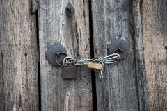 Wooden old doors and padlock Stock Images