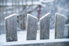 Wooden old fence with snow. Winter Royalty Free Stock Photography