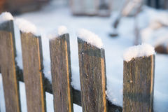 Wooden old fence with snow. Winter Stock Photography