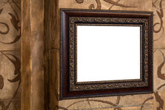Wooden old frame on the wall with empty content Royalty Free Stock Photography