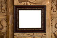 Wooden old frame on the wall with empty content Royalty Free Stock Photo