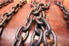 Wooden, old, old brown chest tied with thick, strong metal chains Stock Photos