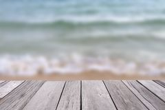 Wooden old plank with blurred sea background. royalty free stock image