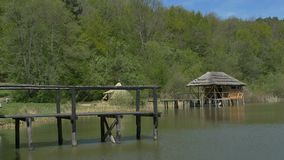 Wooden Old Pontoon. Wood old pier and lake shack on a rural area stock footage