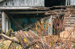 Wooden old ruined house in village Stock Photos
