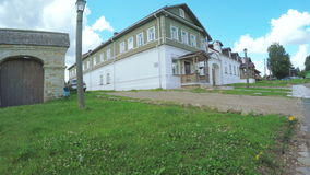 Wooden old Russian house. RUSSIA, PSKOV, JULY, 2016: Panorama Typical wooden houses of Russian village on steadicam, July 2016 in Pskov Russian Federation stock footage