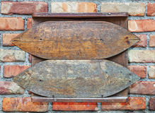 Wooden old sign hanged on brick wall background Stock Photos
