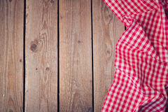 Wooden old table with checked tablecloth. View from above Royalty Free Stock Photography