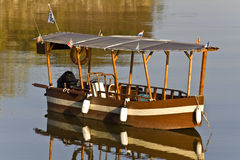 Wooden old traditional greek boat at lake Kerkini Stock Photo