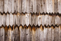 Wooden old wall. Texture old wall of sharpened wooden planks Stock Image