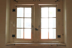 Wooden old window penetrated by sun light stock image