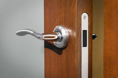 Wooden open door and handle Stock Photography