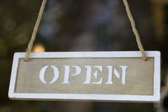 Wooden open sign on a twine Royalty Free Stock Images