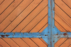 Wooden orange texture. Wood orange fence  texture with blue pattern Stock Photos