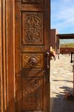 Wooden Ornate Opened Door with stone courtyard Royalty Free Stock Images