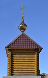 Wooden Orthodox chapel against the blue sky. Royalty Free Stock Photos