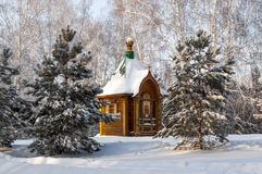 Wooden orthodox chapel, surrounded  forest Royalty Free Stock Photos