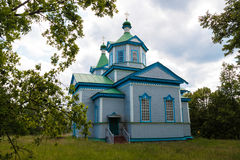 Wooden orthodox church. Beautiful wooden Orthodox church in the woods royalty free stock photos